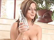 Melissa uses an empty beer bottle as a dildo