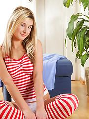 Naughty Nubile blonde in over the knee socks finger bangs her honey coated fuck hole