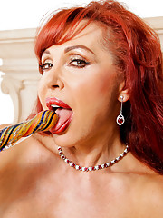 Red haired cougar Vanessa Bella stuffs her milf pussy with a glass toy