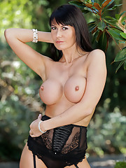 Eva Karera slips off her lace lingerie outdoors unleashing her elegant milf beauty