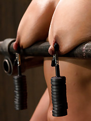 Beretta James is mounted onto the sybian and made to cum. Her nipples and pussy lips are stretched with weights. Her clit is viciously vibed.