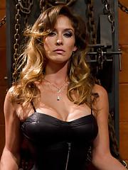 Hot black leather clad dominatrix has dominating sex with muscular slaveboy.