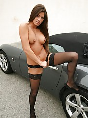 Madelyn Marie poses in black lingerie and stockings by the convertible