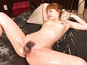 Suzuka Ishikawa with oiled body gets two vibrators on her twat