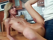 Old senior banging a horny babe in a kitchen