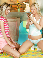 Horny chicks playing with a puppy and cunts