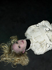 Sarah Jane Ceylon in medical straitjacket and latex bondage