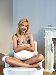 A handsome blonde enjoys undressing herself