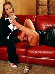 A lesbian fetish chick sucking on her feet