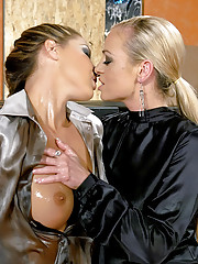 Two lesbian chicks playing with massaging oil