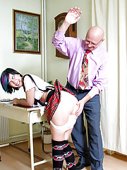 Teacher spanking one of his naughty students