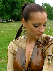 Two hotties playing with liquid food outdoors