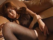 Sakura Ayukawa Asian has pussy fingered by man through fishnet