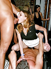 Pretty drunk girls sucking cocks at a club
