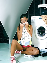 Teenage chick washing her clothes and pussy