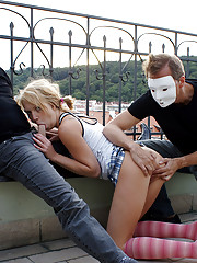 A horny chick nailed by masked men hardcore