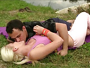 Fellow penetrating a blonde hard near a lake