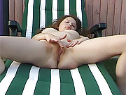 Sunbathing beauty pleasures cunt with hands