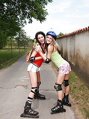 Two skating teen cuties fondling each other