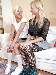 Two gorgeous teen blondes playing with dildos