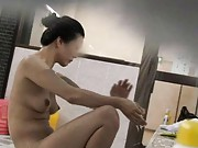 Japanese AV Model with big hooters enjoys shower at public bath