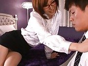 Yuria Satomi Asian with specs shows ass in stockings and thong