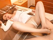 Mei Miura Asian has dildo in twat and feet licked over stockings