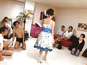 Mayu Nozomi Asian in blue and white outfit is admired by fellows