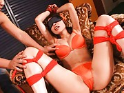 Eri Ouka Asian in orange ropes and lingerie has cum dumpster wet