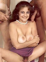 Big titted eighties lady enjoys two big dicks