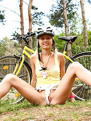 Sporty 18yo schoolgirl Pinky June rides bicycle undressed