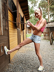 Outdoor photos of Pinky June trying green dildo