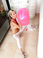 Blue-eyed blonde Pinky June rides a dildo pillow