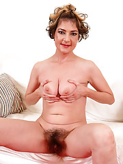 Bushy beaver Eszti plants her long fingers deep into her seasoned muff