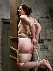 Sarah gets subjected to classic HogTied.com bondage positions, pushed with corporal, face fucking, rope bondage suspensions, and anal orgasms.