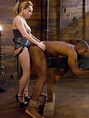 Blonde Dominatrix fucks African American Muscle boy