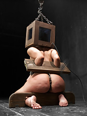 Hot Ashli gets tough metal shackle standing spread, one way mirror head box with cruel wood stocks, and spread wide and double penetrated in a fiddle.