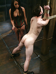Mistress Annie Cruz in military bondage scene