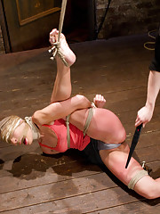 Amber gets bound in an incredibly tough single ankle suspension by rope only - one of the most brutal ties possible seen only on HogTied!