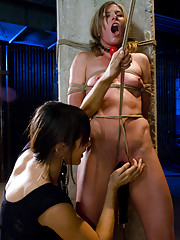 Ariel X and Jade Indica are bound helpless in lesbian BDSM scene. Shocked, vibrated, and made to lick ass!