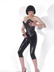 Rubber clad mistress