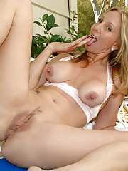 Cheerful mom next door fingers her sweet pussy