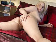 Jenny Davies plays with her hairy pussy in bed