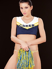 Playful Ann is a sexy little cheerleader