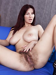 Hairy girl Vanessa J strips and inserts her toy