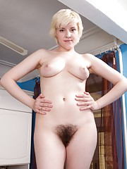 Kira uses stockings to please her hairy pussy