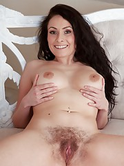 Hairy girl Sophia Delane on antique couch