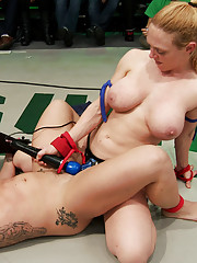 Heavy strap on pussy pounding. A wrestler is thrown into a Boston Crab and fucked with a dick on a stick until she cums on the mats.