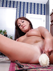 Naughty Anilos Joann Adams fucks her pussy in the kitchen