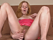 Krista rubs her very hairy pussy after tea